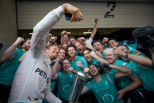 Shanghai International Circuit, Shanghai, China. Sunday 17 April 2016. Nico Rosberg, Mercedes AMG, 1st Position, and the Mercedes team celebrate victory after the race. World Copyright: Steve Etherington/LAT Photographic ref: Digital Image SNE22072