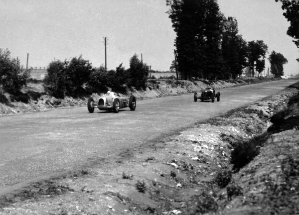"1934 French Grand Prix Montlhery, France. 1 July 1934 August Momberger, Auto Union A, retired, leads Louis Chiron, Alfa Romeo Tipo-B ""P3"", 1st position, action World Copyright: Robert Fellowes/LAT PhotographicRef: 34FRA06"