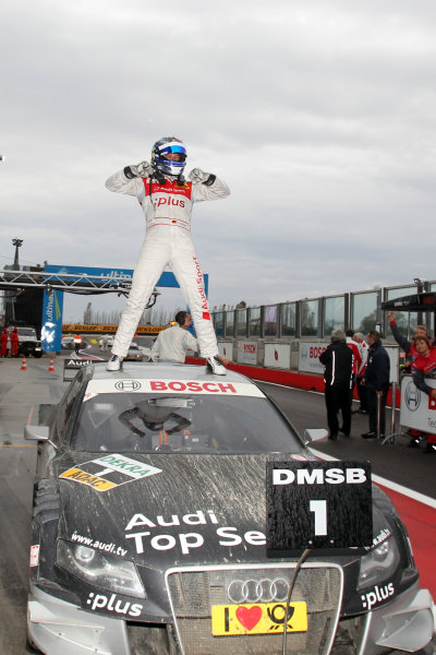 Race winner Timo Scheider (GER), Audi Sport Team Abt celebrates in parc ferme.