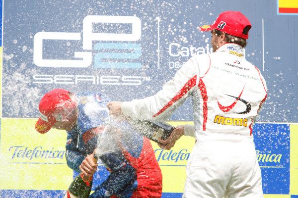 Barcelona, Spain.Sunday Race. 10th May 2009.Edoardo Mortara (ITA, Telmex Arden International) celebrates his first GP2 Series victory on the podium with Jerome D'Ambrosio (BEL, Dams). World Copyright: Glenn Dunbar / GP2 Series Media Service.Ref: _O9T8305 jpg