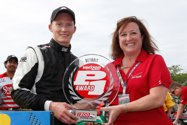 31 May - 2 June, 2013, Detroit, Michigan, USA Race 2 Pole Winner Mike Conway receives the Verizon P1 Pole Award trophy © 2013, Michael L. Levitt LAT Photo USA.