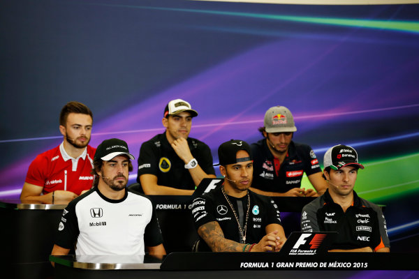 Autodromo Hermanos Rodriguez, Mexico City, Mexico. Thursday 29 October 2015. Will Stevens, Manor F1, Pastor Maldonado, Lotus F1, Carlos Sainz Jr, Toro Rosso, Sergio Perez, Force India, Lewis Hamilton, Mercedes AMG, and Fernando Alonso, McLaren, in the Drivers Press Conference. World Copyright: Glenn Dunbar/LAT Photographic ref: Digital Image _W2Q6142