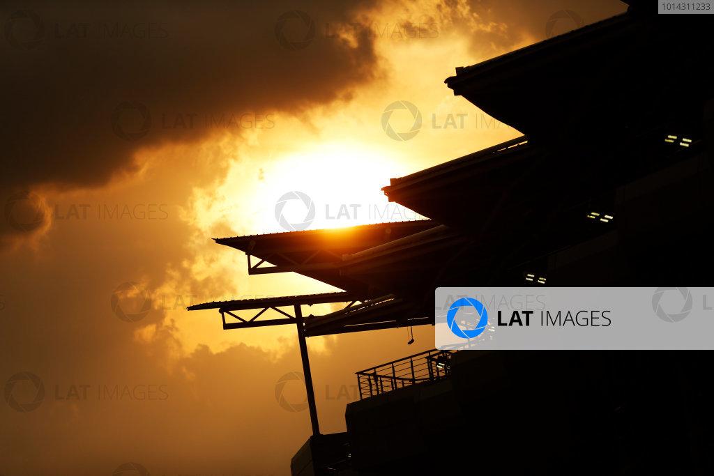 Sepang International Circuit, Sepang, Kuala Lumpur, Malaysia. Thursday 26 March 2015. Sunset over the grandstand. World Copyright: Alastair Staley/LAT Photographic. ref: Digital Image _79P0983