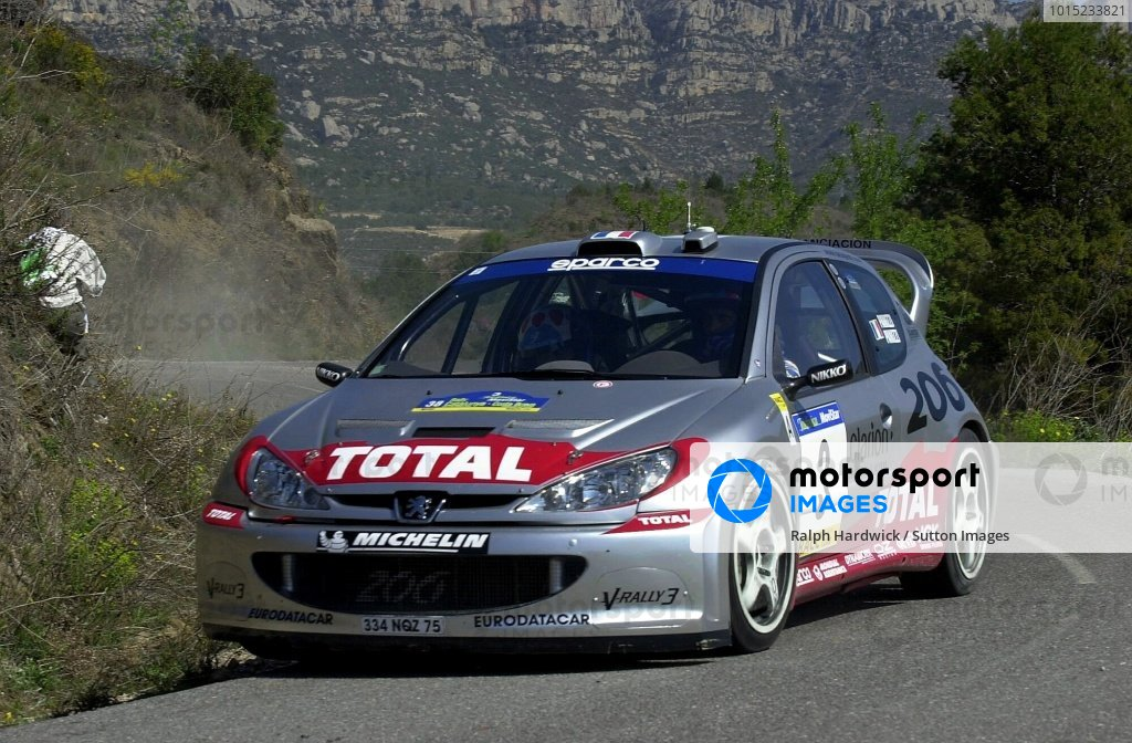 Tour de Corse rally winner Gilles Panizzi (FRA) and co-driver Herve Panizzi (FRA) Peugeot 206 WRC on Stage 3. Tarmac specialist Panizzi dominated by winning every stage of leg 1.