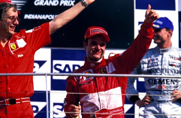 (L-R) Paolo Martinelli (ITA) Ferrari Engine Director, Race winner Rubens Barrichello (BRA) Ferrari and David Coulthard (GBR) McLaren, celebrate on the podium.