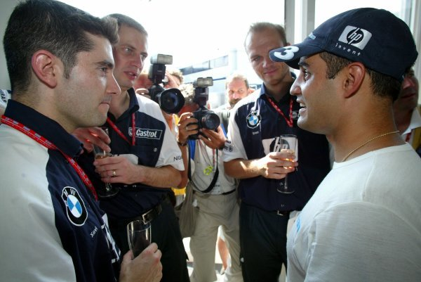 Race winner Juan Pablo Montoya (COL) Williams celebrates victory with Williams team members.Formula One World Championship, Rd12, German Grand Prix, Race Day, Hockenheim, Germany, 3 August 2003.DIGITAL IMAGE