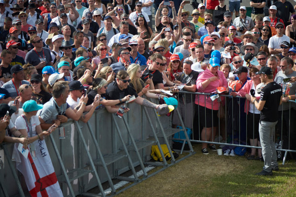 Silverstone Circuit, Northamptonshire, England. Saturday 4 July 2015. Nico Rosberg, Mercedes AMG, signs autographs for fans. World Copyright: Steve Etherington/LAT Photographic ref: Digital Image SNE18815
