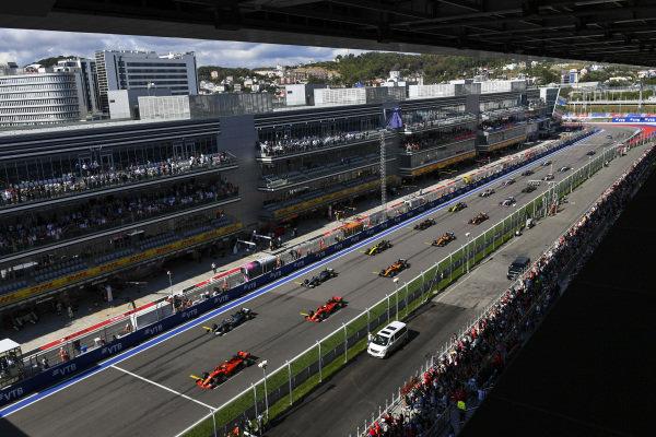 Charles Leclerc, Ferrari SF90, leads Lewis Hamilton, Mercedes AMG F1 W10, Sebastian Vettel, Ferrari SF90, Valtteri Bottas, Mercedes AMG W10, Carlos Sainz Jr., McLaren MCL34, Nico Hulkenberg, Renault R.S. 19, and the rest of the field at the start