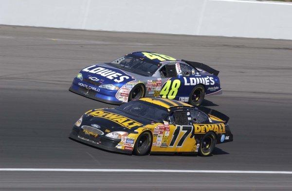 2002 NASCAR,Kansas City,Ks. Sept 26-29, 2002 USA -Jimmie Johnson races the outside of Matt Kenseth,Copyright-Robt LeSieur2002LAT Photographic