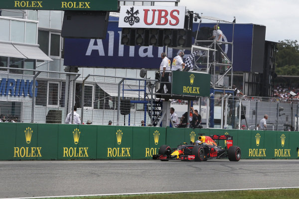 Daniel Ricciardo (AUS) Red Bull Racing RB12 takes the chequered flag at Formula One World Championship, Rd12, German Grand Prix, Race, Hockenheim, Germany, Sunday 31 July 2016.