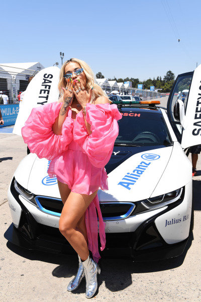 Rita Ora with the Qualcomm BMW i8 Safety car
