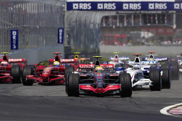 Lewis Hamilton, McLaren MP4-22 Mercedes leads Nick Heidfeld, BMW Sauber F1.07 and Felipe Massa, Ferrari F2007 at the start.