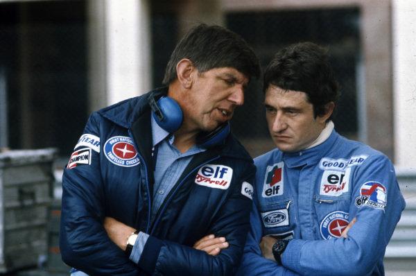 Team boss Ken Tyrrell talks with Patrick Depailler.