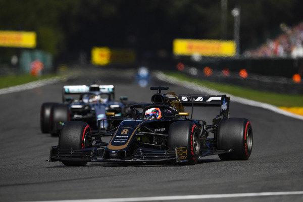 Romain Grosjean, Haas VF-19, leads Lewis Hamilton, Mercedes AMG F1 W10