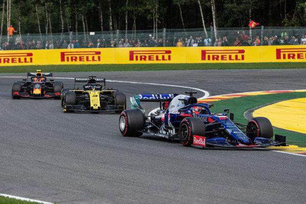 Daniil Kvyat, Toro Rosso STR14, leads Daniel Ricciardo, Renault R.S.19, and Alexander Albon, Red Bull RB15