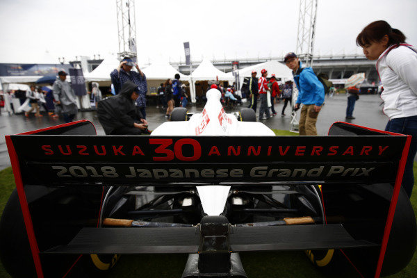 Fans admire a specially liveried 30th anniversary car.
