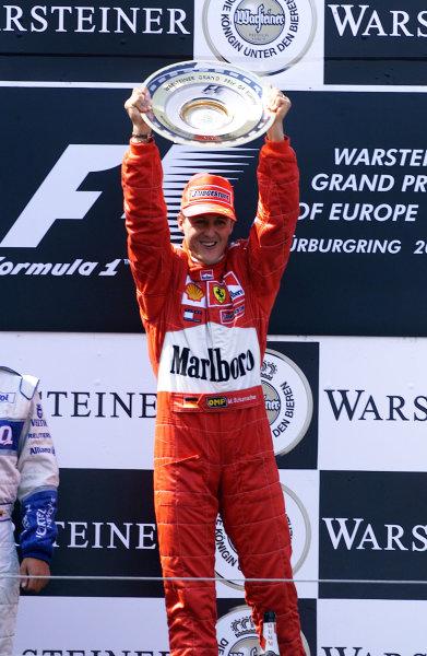 2001 European Grand Prix - Race.Nurburgring, Germany. 24th June 2001.Race winner Michael Schumacher, Ferrari F2001, raises his trophy in triumph - podium.World Copyright: Steve Etherington/LAT Photographicref: 13mb Digital Image Only