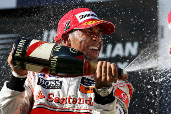 Race winner Lewis Hamilton (GBR) McLaren celebrates on the podium. Australian Grand Prix, Rd 1, Race, Albert Park, Melbourne, Australia, Sunday 16 March 2008. BEST IMAGE