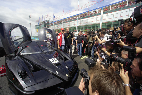Michael Schumacher gives footballer Zinedine Zidane a test drive in a special Ferrari Enzo as part of a fundraising event for a new ICM building project, during the 2007 French Grand Prix at Magny Cours.