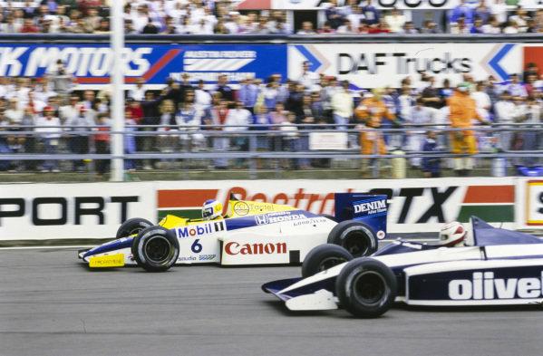 Keke Rosberg, Williams FW10 Honda, battles with Nelson Piquet, Brabham BT54 BMW.