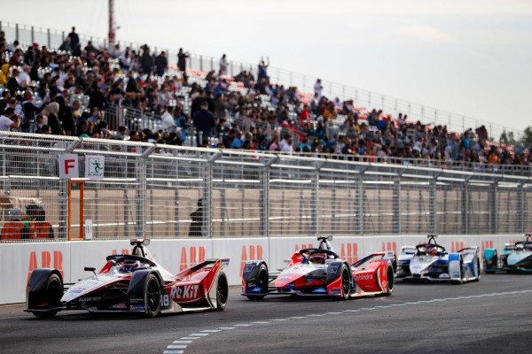 Edoardo Mortara (CHE) Venturi, EQ Silver Arrow 01 leads Jérôme d'Ambrosio (BEL), Mahindra Racing, M6Electro and Maximilian Günther (DEU), BMW I Andretti Motorsports, BMW iFE.20