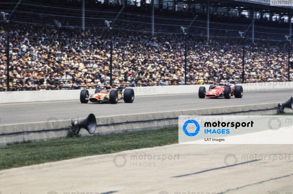 Lloyd Ruby, Gene White, Mongoose Offenhauser, leads Mario Andretti, Andy Granatelli, Hawk III Ford.