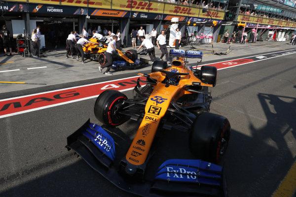 Carlos Sainz Jr., McLaren MCL34, leaves the pits