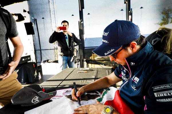 Sergio Perez, Racing Point signs an autograph for a fan