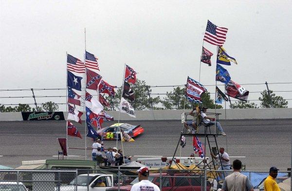 2002 NASCAR,Darlington Raceway,Aug 30-Sept 1 20022002 NASCAR, Darlington,SC. USA -Jeff Gordon speeds past some die hard fans,Copyright-Robt LeSieur2002LAT Photographic