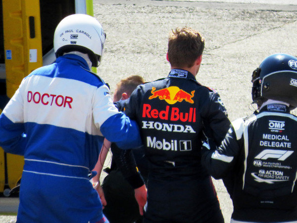 Max Verstappen, Red Bull Racing RB16B is helped from his car into an awaiting ambulance after his crash with Sir Lewis Hamilton, Mercedes W12