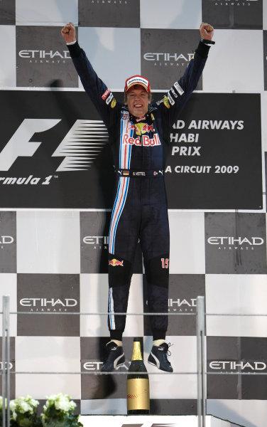 Yas Marina Circuit, Abu Dhabi, United Arab Emirates 1st November 2009. Sebastian Vettel, Red Bull Racing RB5 Renault, 1st position, celebrates victory on the podium. Portrait. Podium.  World Copyright: Steve Etherington/LAT Photographic ref: Digital Image SNE17927