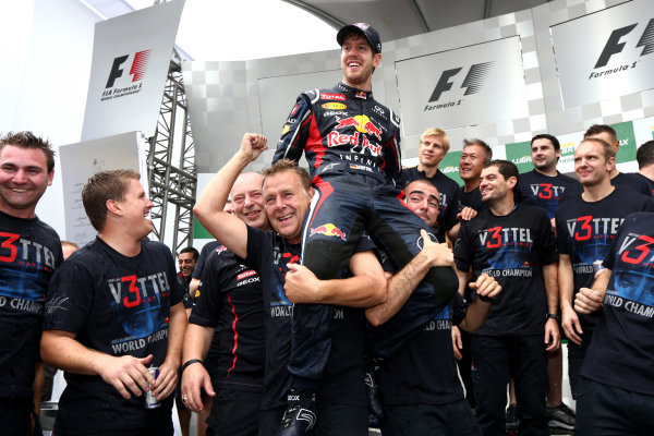 Interlagos, Sao Paulo, Brazil. Sunday 25th November 2012. Sebastian Vettel, Red Bull Racing, 2012 F1 World Champion, celebrates with his team. World Copyright:Andy Hone/LAT Photographic ref: Digital Image HONZ3863
