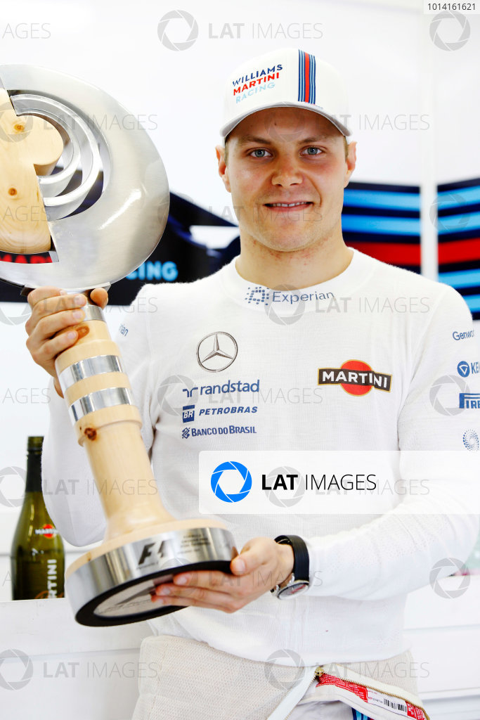 Red Bull Ring, Spielberg, Austria. Sunday 22 June 2014. Valtteri Bottas, Williams F1, 3rd Position, with his trophy. World Copyright: Charles Coates/LAT Photographic. ref: Digital Image _N7T5146