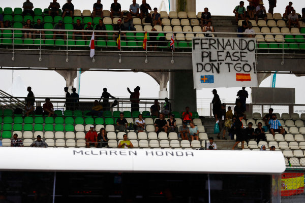 Sepang International Circuit, Sepang, Malaysia. Friday 29 September 2017. Supporters of Fernando Alonso, McLaren MCL32 Honda, display a banner in a grandstand. World Copyright: Steven Tee/LAT Images  ref: Digital Image _R3I2113