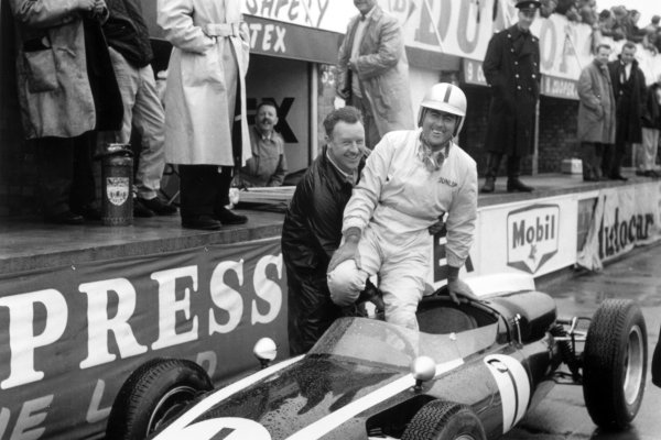 1960 British Grand Prix. Silverstone, Great Britain. 16 July 1960. Thursday practice.  Jack Brabham, Cooper T53-Climax, 1st position, in the pits, portrait. World Copyright: LAT Photographic Ref: Autosport b&w print