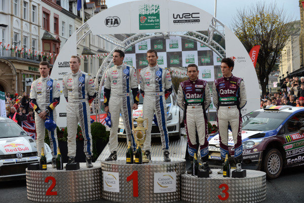 Podium and results: 1st Sebastien Ogier (FRA) Volkswagen, centre. 2nd Jari-Matti Latvala (FIN) Volkswagen, left. 3rd Thierry Neuville (BEL) M-Sport Ford, right. FIA World Rally Championship, Rd13, Wales Rally GB, Deeside, Wales, Day Three, Sunday 17 November 2013.