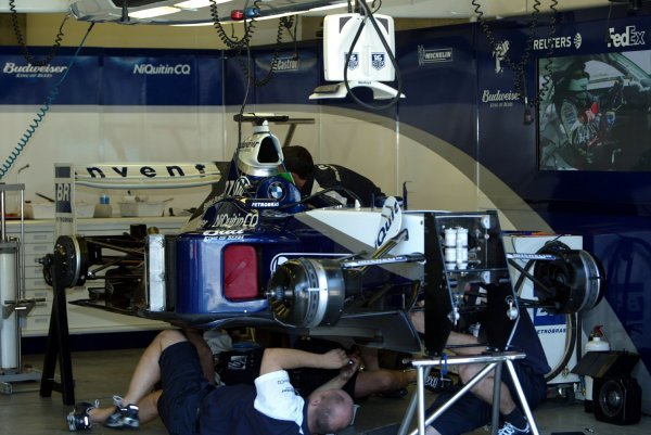 Williams mechanics work in the garage.