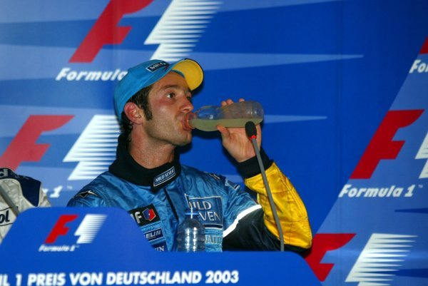 An exhausted third placed Jarno Trulli (ITA) Renault in the press conference. Formula One World Championship, Rd12, German Grand Prix, Race Day, Hockenheim, Germany, 3 August 2003.DIGITAL IMAGE