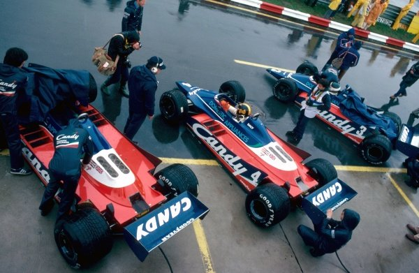 The three Tyrrell 010 cars in the pit lane.