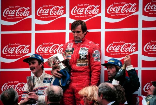 There was little to celebrate for race winner Carlos Reutemann (ARG) Williams (centre) following his accidental involvement in the fatal accident of Osella mechanic Giovanni Amedeo on the Friday. Jacques Laffite (FRA) Ligier (Right) was second and Nigel Mansell (GBR) (Lotus) (left) took his first podium finish with third.