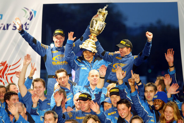 2003 FIA World Rally Champs. Round fourteen Wales Rally GB 6th-9th November 2003.The Subaru team on the podium.World Copyright: McKlein/LAT