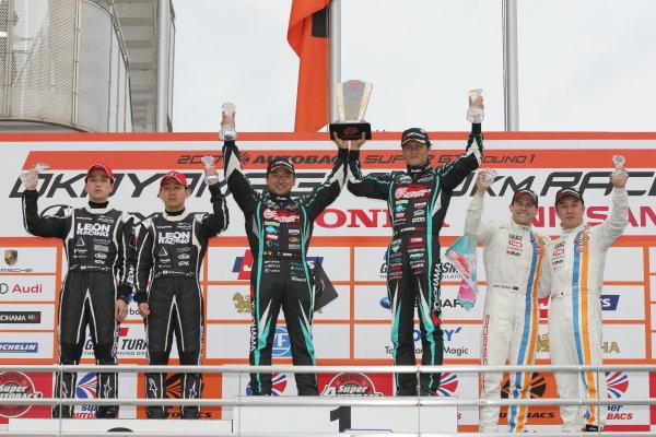 2017 Japanese Super GT Series. Okayama, Japan. 8th - 9th April 2017. Rd 1. GT300 Winner Nobuteru Taniguchi & Tatsuya Kataoka ( #4 GOODSMILE HATSUNE MIKU AMG ) 2nd position Haruki Kurosawa & Naoya Gamou ( #65  LEON CVSTOS AMG ) 3rd position Satoshi Jono Lester & Kyosuke Mineo ( #9 GULF NAC PORSCHE 911 ) podium, portrait World Copyright: Yasushi Ishihara / LAT Images. Ref: 2017SGT_Rd1_011