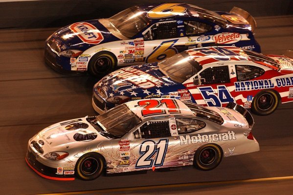 Three wide racing in a seventy lap exhibition race (Top to Bottom): Seventeenth placed Mark Martin (USA) Viagra Ford; thirteenth placed Todd Bodine (USA) Discover Card Ford; Ricky Rudd (USA) Motorcraft Quality Parts Ford who finished eighth. 