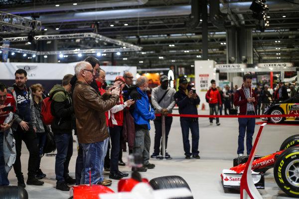 Autosport International Exhibition. National Exhibition Centre, Birmingham, UK. Saturday 13th January 2018. Visitors examine a Ferrari on display.World Copyright: Jakob Ebrey/LAT Images Ref: JR3_3775