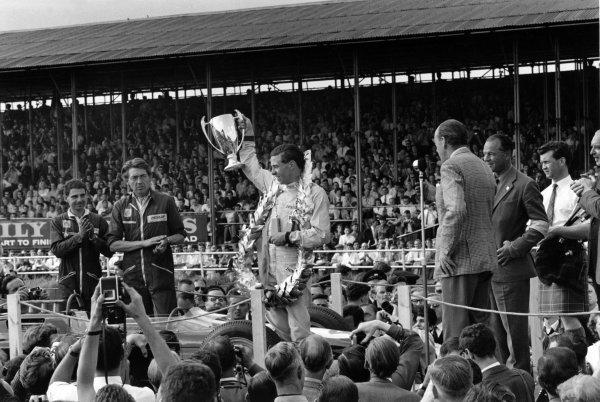 1963 British Grand Prix.Silverstone, Great Britain. 20 July 1963.Jim Clark, Lotus 25-Climax, 1st position, podium.World Copyright: LAT PhotographicRef: L63/217/27