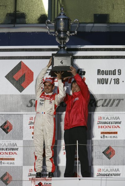 2006 Formula Nippon ChampionshipRd 9. Suzuka, Japan. 19th November 20062006 Drivers Champion - Benoit Treluyer (mobilecast IMPUL), with team director Kazuyoshi Hoshino. Podium.World Copyright: Yasushi Ishihara / LAT Photographicref: Digital Image 2006FN_R9_015