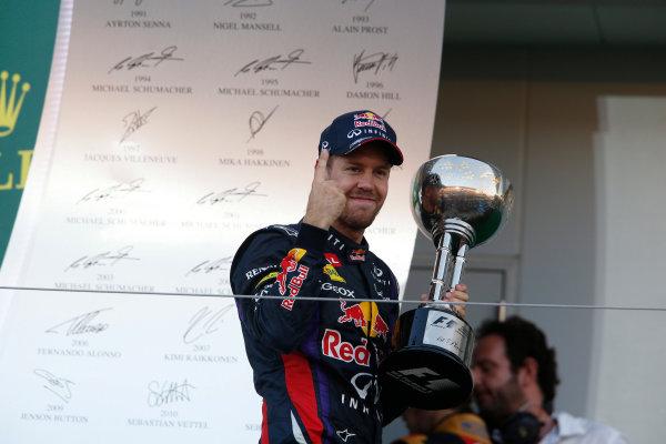 Suzuka Circuit, Suzuka, Japan.  Sunday 13th October 2013.  Sebastian Vettel, Red Bull Racing, 1st position, on the podium with his trophy. World Copyright: Charles Coates/LAT Photographic  ref: Digital Image _N7T7393