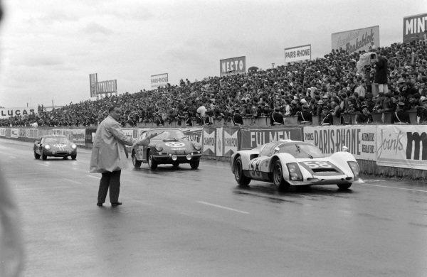 Günther Klass / Rolf Stommelen, Porsche System Engineering, Porsche 906/6 Carrera 6, leads Jacques Dewes / Jean Kerguen, J. Franc, Porsche 911 S, and Henri Grandsire / Leo Cella, Sociètè des Automobiles Alpine, Alpine A210 - Renault, into parc fermé at the end of the race.