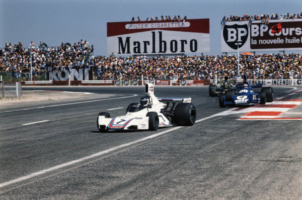 Carlos Reutemann, Brabham BT44B Ford leads Patrick Depailler, Tyrrell 007 Ford and Ronnie Peterson, Lotus 72E Ford.