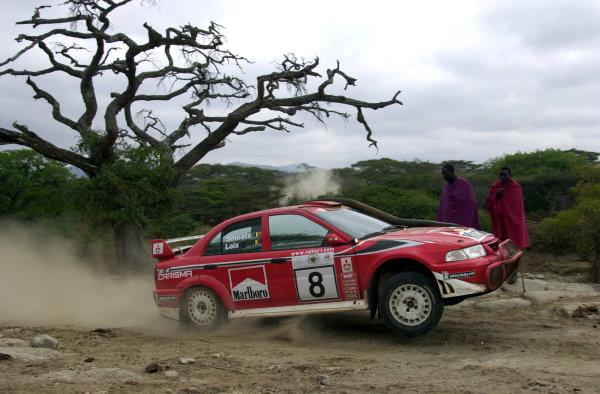 2001 World Rally Championship.Nairobi, Kenya. July 20-22, 2001Feddy Loix drives by masai onlookers on the final leg.Photo: Ralph Hardwick/LAT